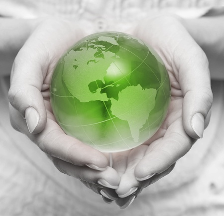 Human hands holding and take care about green planet   photo