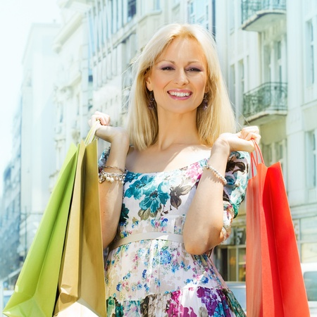 Attractive shopping woman with bags  Stock Photo - 13168932