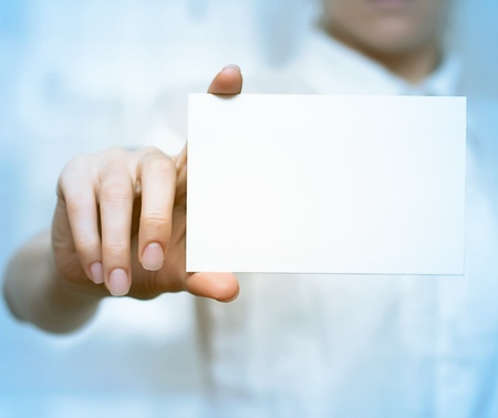Blank business card in hands.