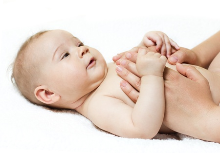 massaging: baby massage  Stock Photo