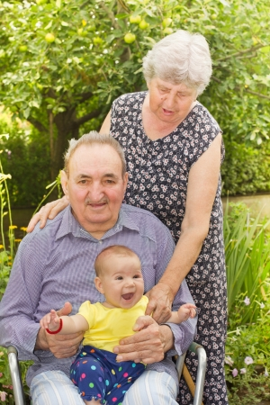 Portrait of an elderly couple with a granddaughter in the backyard Stock Photo - 14959166