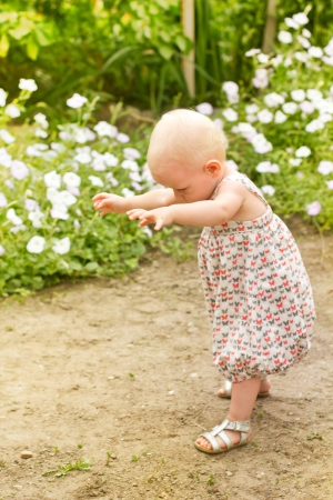 Baby girl,one year old ,making her first step in the park
