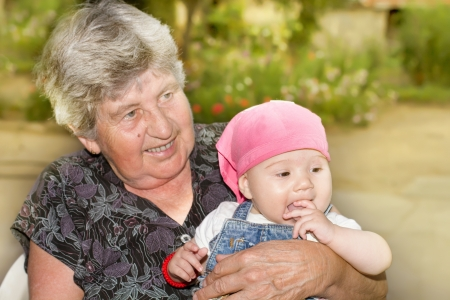 Portrait of smiling senior woman with little granddaughter in the backyard Stock Photo - 15693018