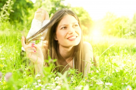 Portrait of beauty girl relaxing in nature. photo