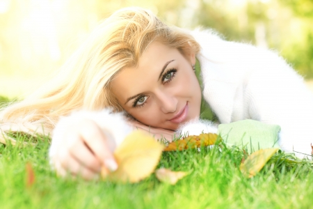 Beautiful young woman relaxing on the grass. photo