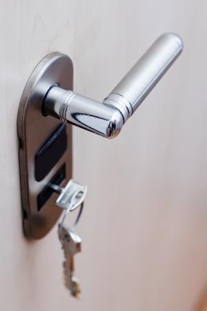 security door: A key in a lock at safety door.