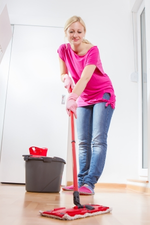 mopping: Female cleaning and mopping floor at home. Stock Photo