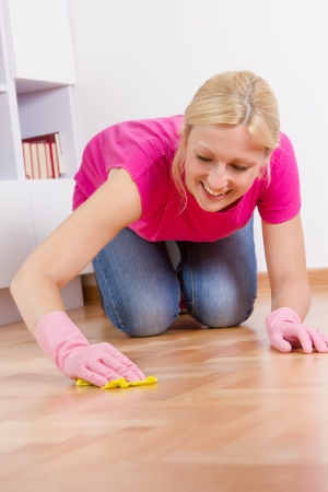 housemaid: Young woman cleaning and mopping floor at home.