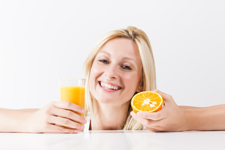 Healthy young woman with orange juice. photo