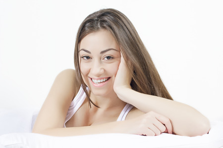 Sensual young woman relaxing on the bed. Stock Photo - 24297193