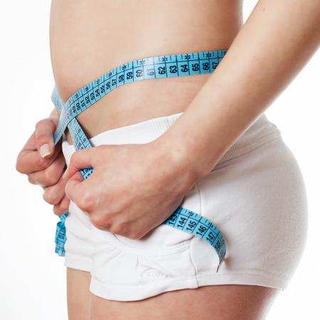 cintura perfecta: Joven medir la cintura perfecta.