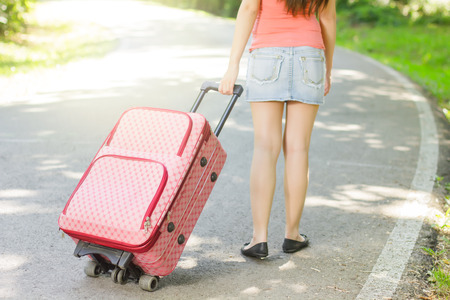 Attractive woman with a suitcase ready for travel. Stock Photo - 29545138