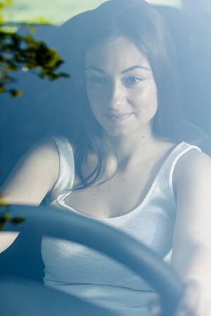 Beautiful young woman driving a car. photo