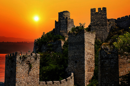 Medieval fortified town on the Danube River in Serbiab at sunset.