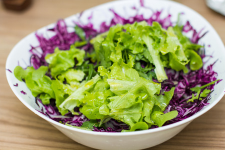 red cabbage: Fresh Healthy Food with Green Salad and Red Cabbage.