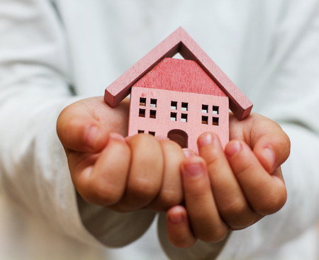 House model in the child hand.Investment for the Future. Stock Photo