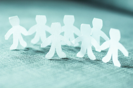 business symbols: Paper doll people chain teamwork.