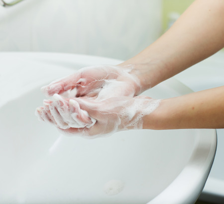 white wash: Washing Hands with soap in bathroom. Hygiene