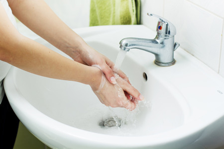 cleanly: Washing Hands with streaming water in bathroom. Hygiene Stock Photo