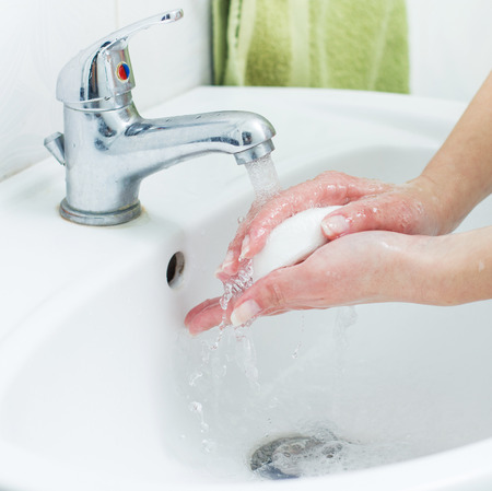 cleanly: Washing Hands with soap in bathroom. Hygiene