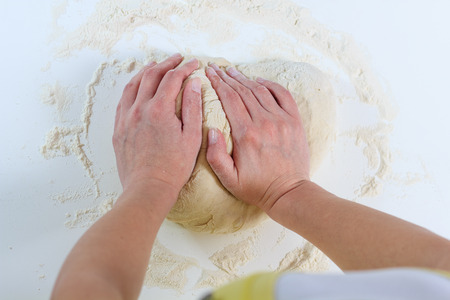preparing food: Female Hands Kneading Dough for baking .Homemade Preparing Food.