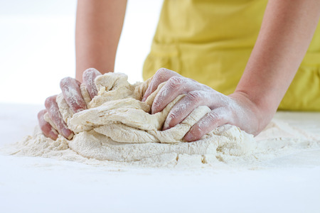 preparing food: Female Hands Making Dough for baking .Homemade Preparing Food. Stock Photo