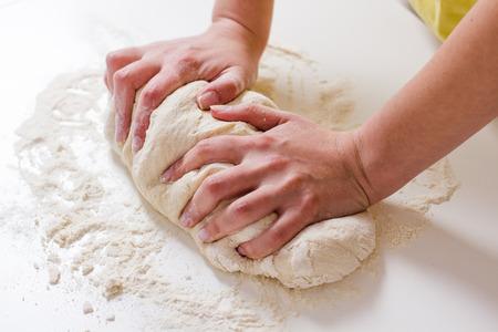 Female Hands Making Dough for baking .Homemade Preparing Food. Фото со стока