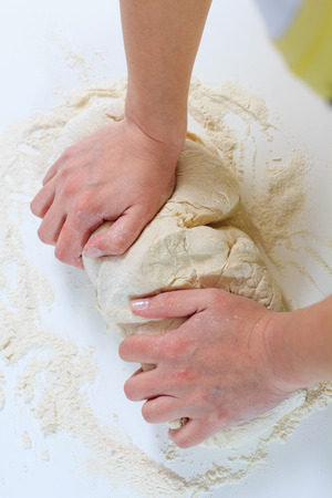 culinary skills: Female Hands Making Dough for baking .Homemade Preparing Food. Stock Photo