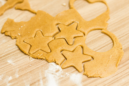 star shaped: Christmas cookies gingerbread dough star on wooden table.
