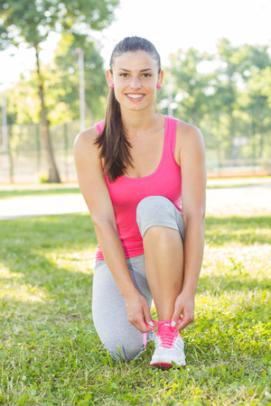 outdoor fitness: Fitness, Healthy Lifestyle, Smiling Female ready for practicing outdoor. Stock Photo