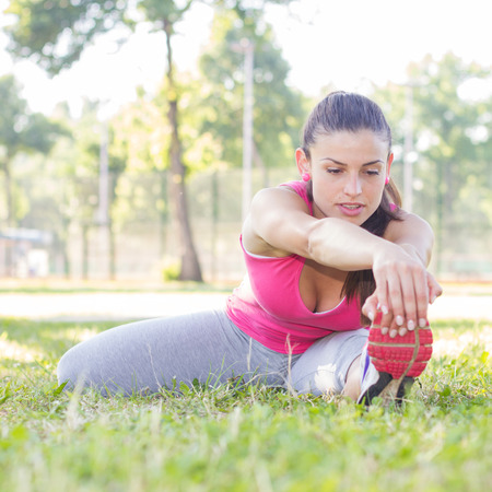 outdoor fitness: Fitness Young Woman Doing Stretching Exercises , Healthy Lifestyle, Beautiful summer day , Outdoor activity. Stock Photo