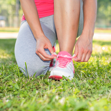 shoelaces: Close up of Fitness Woman  tying shoelaces outdoor. Stock Photo