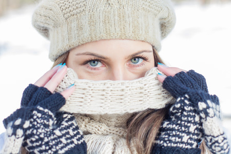 cold season: Winter Portrait of Female with Beautiful Blue Eyes outdoor