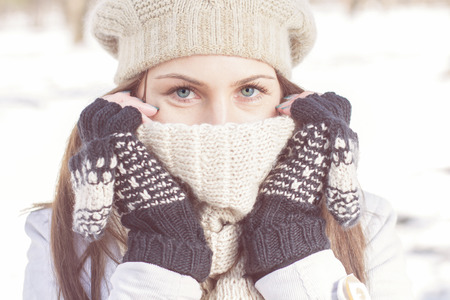 Winter Portrait of Female with Beautiful Blue Eyes outdoor