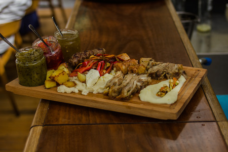 catering food: Catering Food, tasty meal served on a wooden board in a restaurant. Stock Photo