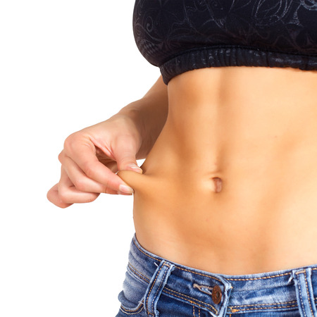 ideal: Slim Waist of Young Woman with perfect healthy thin body,showing her belly after successful diet.