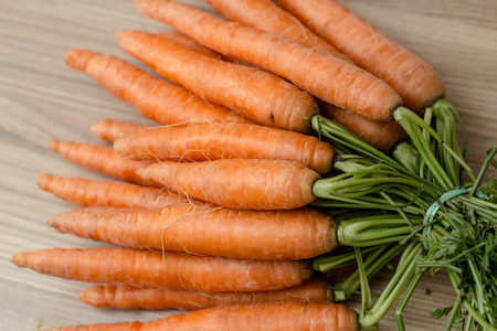 carrot: Fresh Carrots Bunch over wooden background.