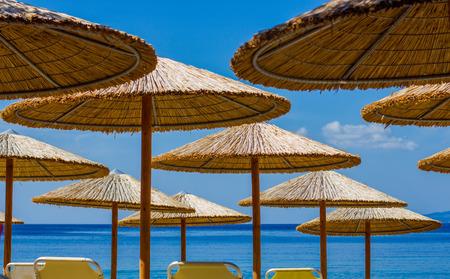 blue summer sky: Sunshade On The Beach over blue summer sky.