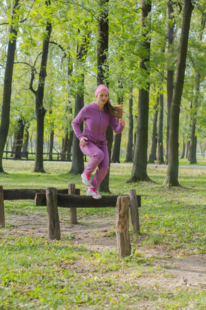 hurdles: Fitness Young Woman Exercising ,Training Outdoor, jumping over hurdles,Healthy lifestyle