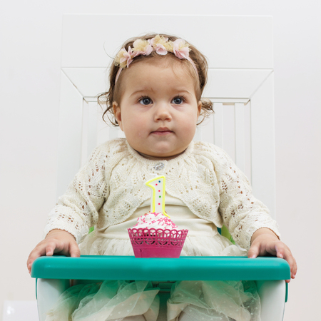 party pastries: Celebrating First Birthday , portrait of cute little girl with cake. Stock Photo
