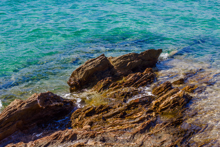 shore: Coast with rocks on the beautiful turquoise Aegean Sea. Chalkidiki, Greece. Stock Photo