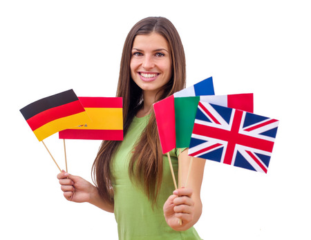 languages: Portrait of Happy beautiful student female with international flags. Stock Photo