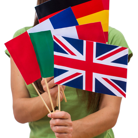 language school: Student female holding international flags. Support or language school concept.
