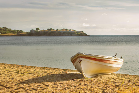 sandy beach: Fishing Boat on the sandy beach at sunset, beautiful summer scene, travel destination, with space for message