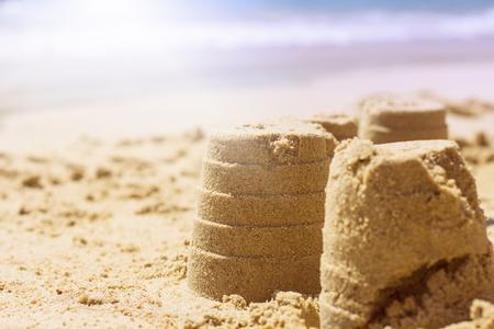 sandcastle: Summer Creative Fun sandcastle on the beach.