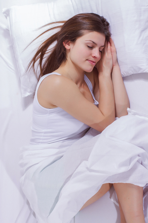 Sleeping woman, young beautiful caucasian female sleep in the bed. Stock Photo