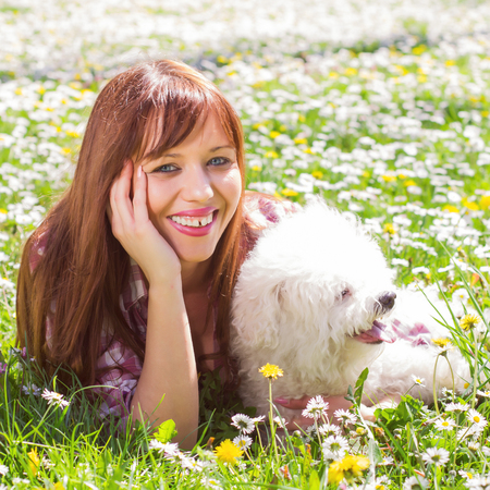 woman in field: Happy beautiful young woman, enjoying nature with her dog, at sunny spring day in the park.