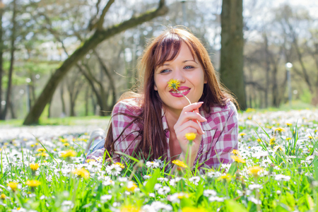 carefree: Happy beautiful spring young woman enjoying nature , carefree lifestyle outdoor. Stock Photo