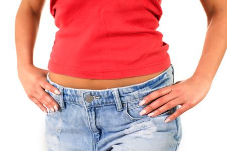 body torso: Slim Attractive Waist woman in jeans show thin body.