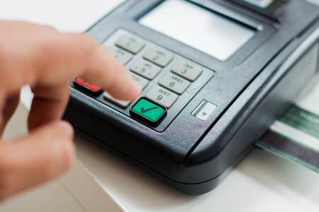 cardreader: Payment with credit card by paying POS terminal. Stock Photo